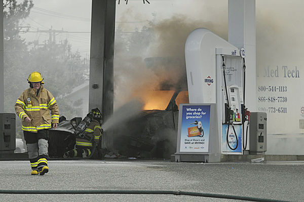 Fire fighters suppress the fireball erupted when a Coastal Med Tech delivery truck struck a gas pump Monday, June 7, 2010  at the Irving Circle K in Harrington.(Edwin Barkdoll photo)