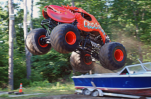 Greg Winchenbach of Jefferson took his monster truck &quotCrushtation&quot over a motor boat during an early test run in July 2009. (photo: courtesy of Greg Winchenbach)