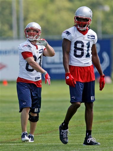 New England Patriots wide receivers Wes Welker (83) and Randy Moss (81) look on during NFL football practice in Foxborough, Mass., Wednesday, June 2, 2010. (AP Photo/Stew Milne)
