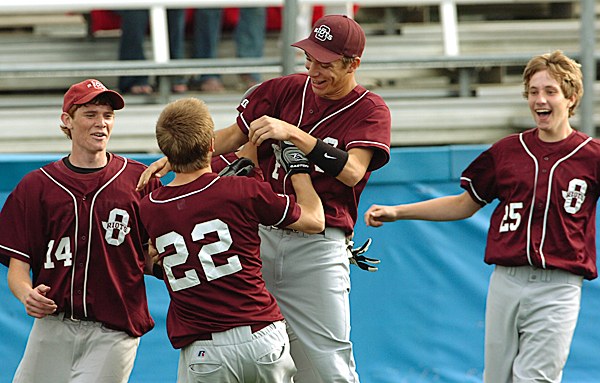 Orono's #22 Charlie Boyle is mobbed by teammates after scoring the winning run against Houlton at Orono on Tuesday, June 8, 2010. BANGOR DAILY NEWS PHOTO BY KEVIN BENNETT