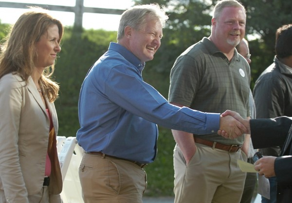 Democratic gubernatorial candidate Pat McGowan (center) greets voters outside the Bangor Civic Center on Tuesday, June 8, 2010 alongside his wife Kirsten (left) and state representative Jim Martin (D-Orono). (Bangor Daily News/Bridget Brown)