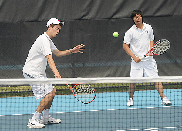 George Stevens Academy's  Jasper Adam makes a return while teammate  Erik Kim looks on during their march against Madawaska High School's Jamie Cyr  and Jacques Daigle during the class C championship tennis meet at Colby College in Waterville.  Adam and Kim won the match 6-3, 7-6, (0). BANGOR DAILY NEWS PHOTO BY GABOR DEGRE