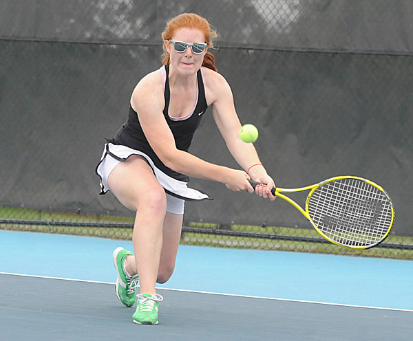 George Stevens Academy's Grace Jackson makes a return during her  1st singles match against Dexter High School's Crissy Mountain during the class C championship tennis meet at Colby College in Waterville. Mountain won the match 1-6, 6-2, 6-4. BANGOR DAILY NEWS PHOTO BY GABOR DEGRE