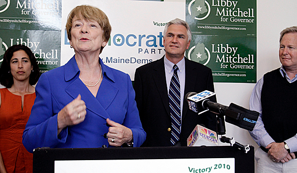 Democratic gubernatorial candidate Libby Mitchell, front, praises her former opponents, background,  during a show of party unity at a news conference in Portland, Maine, on Wednesday, June 9, 2010. At left is Rosa Scarcelli, Steve Rowe, and Pat McGowan. (AP Photo/Pat Wellenbach)