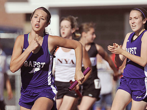 John Bapst's Maggie Lynn, right, makes the hand-off to teammate Stesha Rudnicki  on the anchor leg of the girl's 4x100 meter relay at the State CLass C Meet in Dover Foxcroft, Maine, Wed., June 9, 2010. BANGOR DAILY NEWS PHOTO BY MICHAEL C. YORK