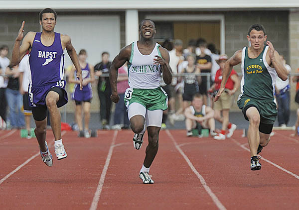 Stuart Lenz of John Bapst and Jared Waite of Schenck were neck and neck again in the boy's 100m dash at the State CLass C Meet in Dover Foxcroft, Maine, Wed., June 9, 2010. BANGOR DAILY NEWS PHOTO BY MICHAEL C. YORK