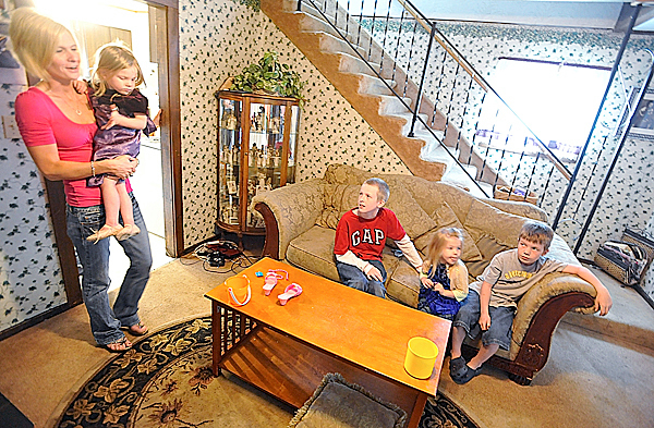 Lisa Hamel held her twin daughter Addisyn Hamel (cq), 3, as she talked with her son Kameron Seger (cq),11, daughter Brooklynn Hamel (cq) , 3 and son Peyton Hamel, 7, in their living room Thursday afternoon, June 10, 2010.  Kameron Seger performed CPR on his mom after she fell down the stairs (seen in background of photo) at their home in Glenburn last week. BANGOR DAILY NEWS PHOTO BY JOHN CLARKE RUSS