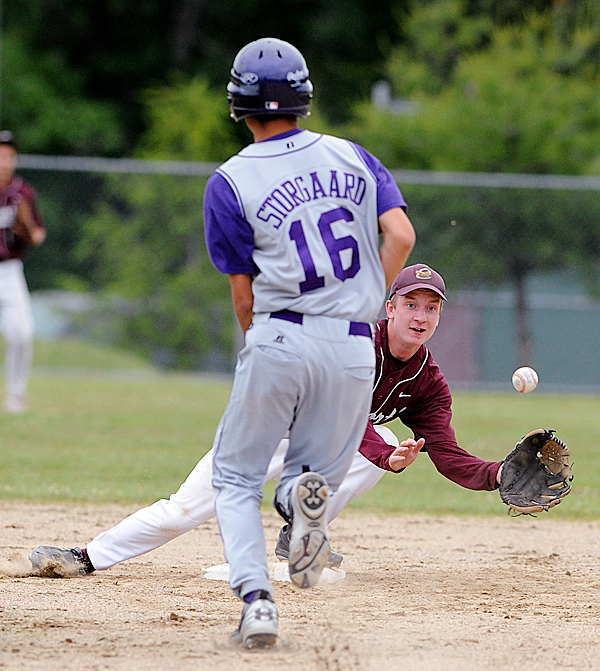 Ellsworth High School's Brad Folmer (right) makes the catch at second base to force out John Bapst's Matt Storgaard during the 3rd inning of the quarterfinal game in Ellsworth Thursday evening. BANGOR DAILY NEWS PHOTO BY GABOR DEGRE