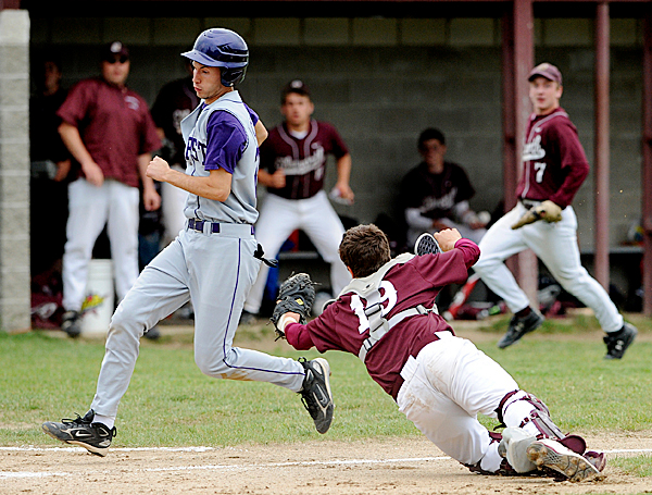 Ellsworth High School's catcher Jordan Carter (right) can't reach John Bapst's Nick Christie as he was running to the home plate during the 3rd inning of the quarterfinal game in Ellsworth Thursday evening. BANGOR DAILY NEWS PHOTO BY GABOR DEGRE