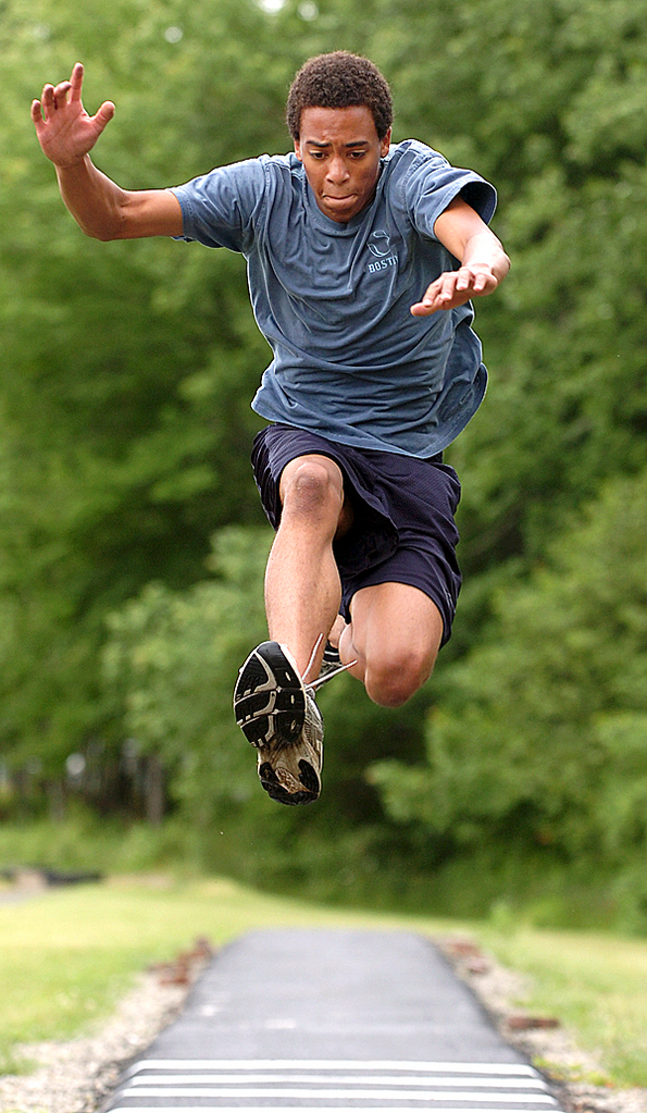 Medomak Valley High School student Nate Mead practices his triple jump technique at the school's track on Thursday, June 11, 2010.  BANGOR DAILY NEWS PHOTO BY KEVIN BENNETT
