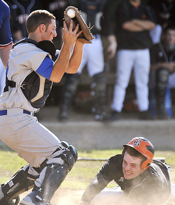 Lewiston catcher Trey Ouellette takesa a high throw to the plate as Brewer's Kyle McLain, (17), slides in safely for the score in the fourth inning of their game in Brewer, Friday, June 11, 2010.   BANGOR DAILY NEWS PHOTO BY MICHAEL C. YORK