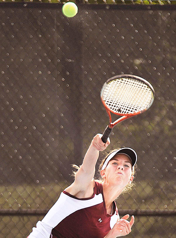 Caribou's Jenna Sealander serves to her opponent in the tennis championship at Colby College in Waterville, Saturday, JUne 12, 2010.   BANGOR DAILY NEWS PHOTO BY MICHAEL C. YORK