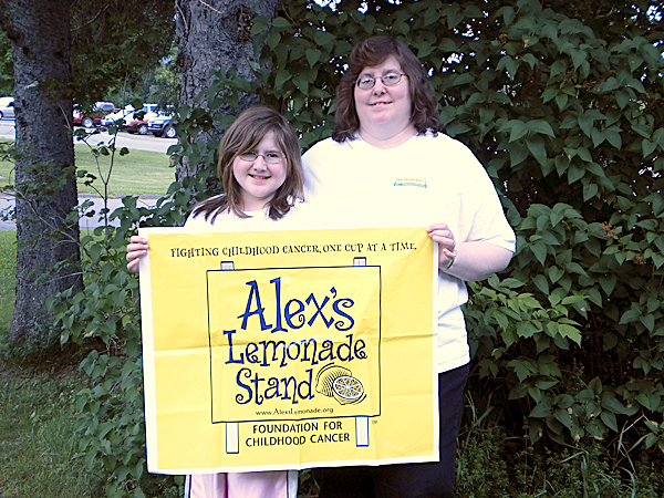 CUT LINE, MARS HILL -- Jessica Cropley, left, and her mother, Cathy Cropley, display the sign for their Alex's Lemonade Stand. The Cropley's have manned such a stand annually for the past seven years, both in Mars Hill and Westfield, in order to raise money for pediatric cancer.  PHOTO COURTESY OF CATHY CROPLEY