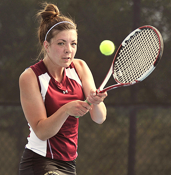 Caribou's Laura Collins  returns a volley during her match in the tennis championship at Colby College in Waterville, Saturday, June 12, 2010.  BANGOR DAILY NEWS PHOTO BY MICHAEL C. YORK