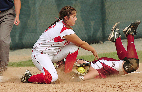 Bangor's Mariah Cassum is tagged by Cony's Laina Younes at third base during 1st inning action on Saturday, June 12, 2010. Cassum was called safe.  BANGOR DAILY NEWS PHOTO BY KEVNI BENNETT