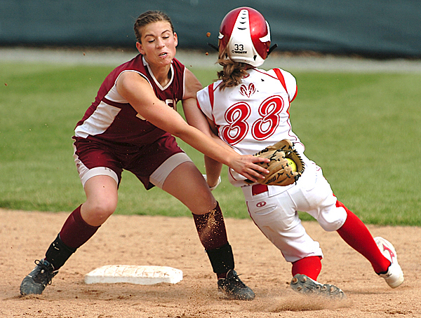 Bangor's Mariah Cassum misses a tag on Cony's Nicole Rugan during 2nd inning action on Saturday, June 12, 2010 at Bangor. Rugan over shot the bag and was  tagged out by Cassum.  BANGOR DAILY NEWS PHOTO BY KEVNI BENNETT