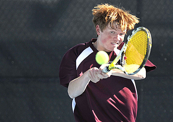 Cape Elizabeth's  Ross Sherman hits a two handed shot to CAmden Hills' Pierre Haugen Saturday, June 12, 2010,  at the championships held at Colby College in Waterville. BANGOR DAILY NEWS PHOTO BY MICHAEL C. YORK