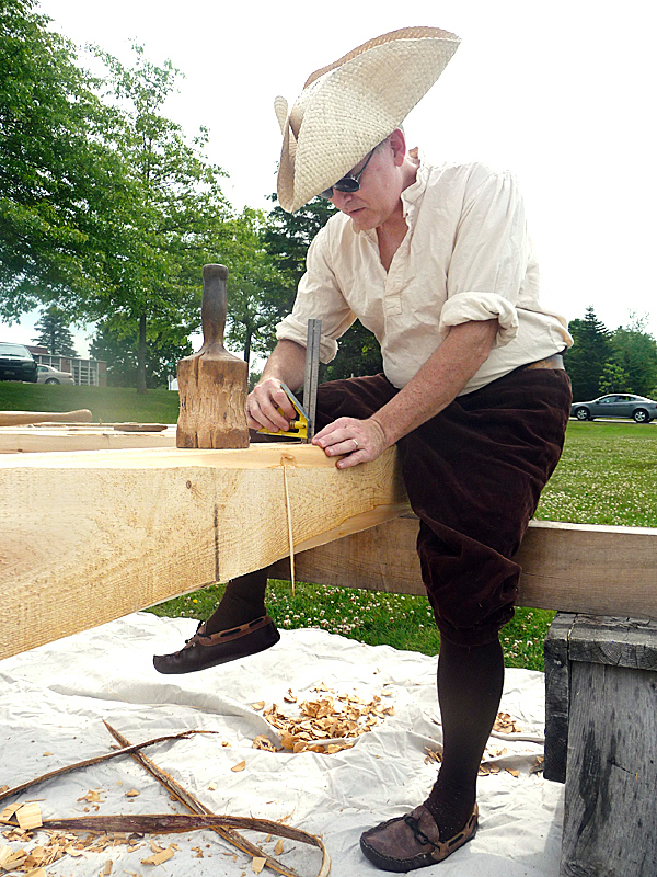 Nate Beal of Marshfield works on constructing a timber frame porch Saturday using traditional tools. Beal was one of dozens of craftsmen at Margaretta Day at Machias. Held on the University of Maine at Machias campus, Margaretta Day celebrates the history of the town and commemorates the first naval battle of the Revolutionary War in Machias Bay. In that battle, Machias colonists captured the British ship Margaretta.(Bangor Daily News/Sharon Mack)