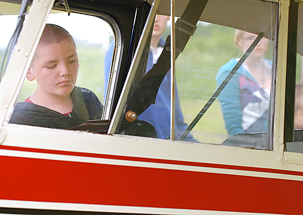 Nathan Hart, 13, of Prospect looks inside a 1946 Aeronca Champ airplane as part of International Young Eagles Day which offered free flights to youth ages 7-17 from the Belfast Municipal Airport on Saturday, June 12, 2010. Nearly a dozen pilots from the Belfast and Bangor areas volunteered their time, skills and airplanes for the program which is organized internationally by the Experimental Aircraft Association, or EAA. BANGOR DAILY NEWS PHOTO BY BRIDGET BROWN
