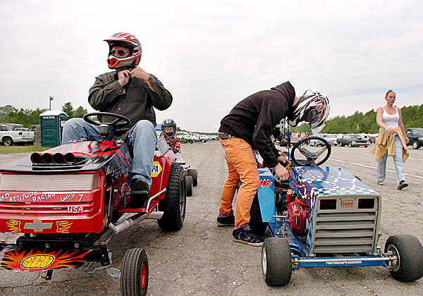Lenny Voisine (left) of Waldoboro and Gage Reynolds (right) of Bangor prepare to race their modified lawn mowers and tractors at the Winterport Dragway on Saturday, June 12, 2010. A half-dozen racers participated in the shootout event, which has been a crowd favorite at the dragway since its inception four years ago. BANGOR DAILY NEWS PHOTO BY BRIDGET BROWN