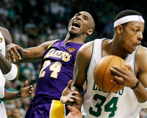 Los Angeles Lakers guard Kobe Bryant (24) reacts after Boston Celtics forward Paul Pierce (34) ripped away a rebound during the fourth quarter in Game 5 of the NBA basketball finals Sunday, June 13, 2010, in Boston. (AP Photo/Winslow Townson)