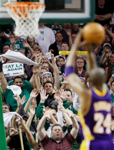 Boston Celtics fans try to distract Los Angeles Lakers guard Kobe Bryant (24) as he shoots a free throw during the fourth quarter in Game 5 of the NBA basketball finals Sunday, June 13, 2010, in Boston. (AP Photo/Michael Dwyer)