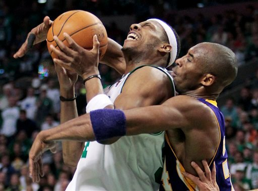 Los Angeles Lakers guard Kobe Bryant, right, defends against Boston Celtics forward Paul Pierce during the fourth quarter in Game 5 of the NBA basketball finals Sunday, June 13, 2010, in Boston. (AP Photo/Michael Dwyer)