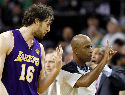 Los Angeles Lakers forward Pau Gasol (16) of Spain, argues with referee Derrick Stafford during the fourth quarter in Game 5 of the NBA basketball finals against the Boston Celtics on Sunday, June 13, 2010, in Boston. (AP Photo/Michael Dwyer)