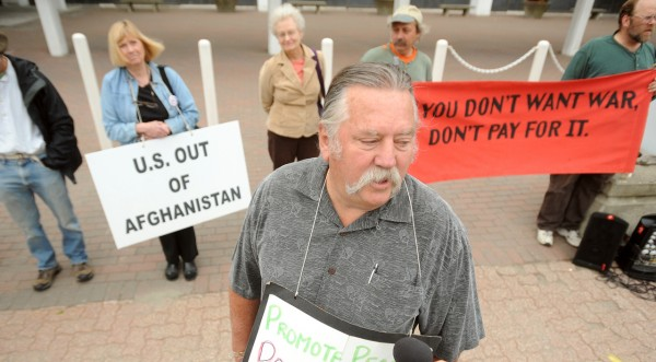 Long time tax resister and peace activist Frank Donnelly (center) with supporters outside the Federal Court House in Bangor Monday, June 14, 2010.  Donnelly, who has refused to pay taxes for the past 40 years, was sentenced in federal court.  (Bangor Daily News/Gabor Degre)