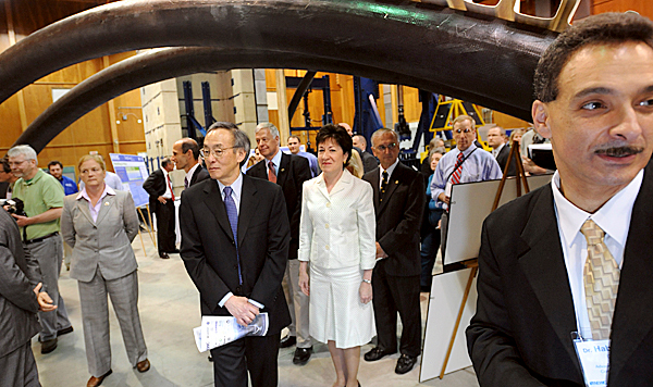 Professor Habib Dagher (right) lead the tour of U.S. Secretary of Energy Steven Chu (center left) during his visit to the Advanced Structures and Composites Center at the University of Maine in Orono Monday.  Secretary Chu was invited to Maine by U.S. Sen. Susan Collins (center right). BANGOR DAILY NEWS PHOTO BY GABOR DEGRE