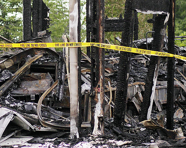 Rubble of Scott Bartlett home, Stonington, Maine, Monday June 14, 2010. (Bangor Daily News/Michael C. York)