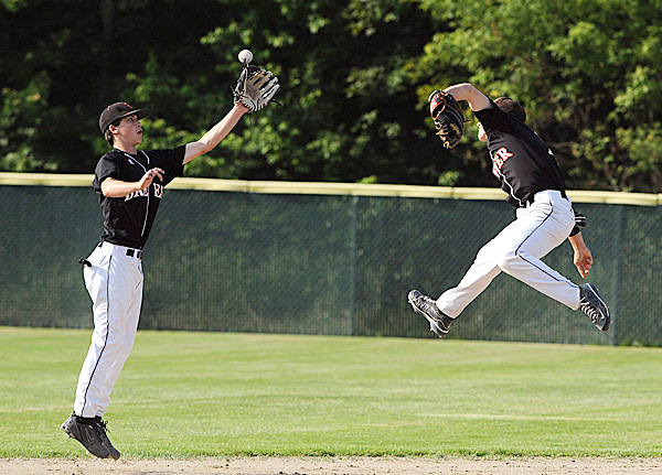 Brewer High School's #2 Jordan Smith (right) and #13 Tyler Libby both fail to make the catch at second base during the second inning of the Easter Maine Class A Baseball final game against Oxford Hills High School in Augusta Tuesday afternoon.