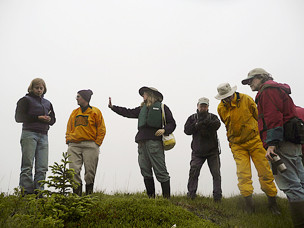 Amateur botanist Marilee Lovit of Addison explains the topography of Tibbett Island to a group of enthusiasts recently. Lovit and Donna Kausen, also of Addison, have recently documented all the flora and fauna in Acadia National Park for a new reference book. BANGOR DAILY NEWS PHOTO BY SHARON KILEY MACK