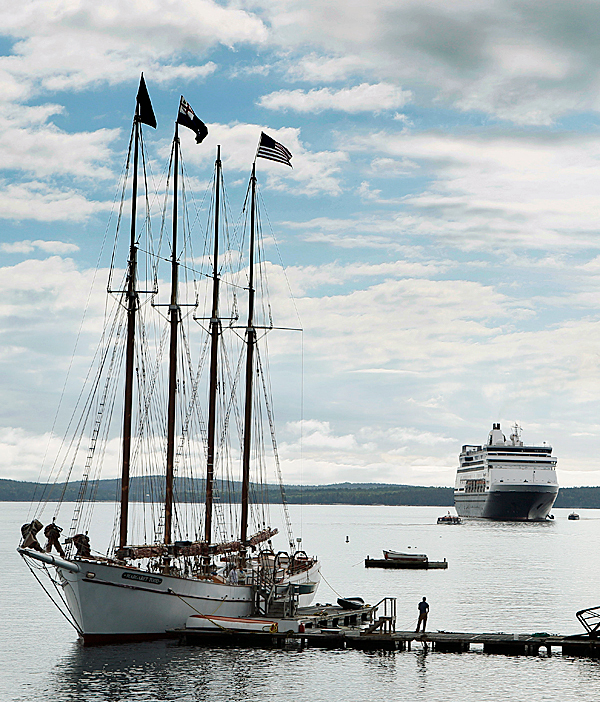In this  June 4, 2010 photo, the Maasdam, a 1258-passenger cruise ship, sits at anchor in Frenchman's Bay off Bar Harbor, Maine. A four-masted windjammer is docked in the foreground. (AP Photo/Robert F. Bukaty)