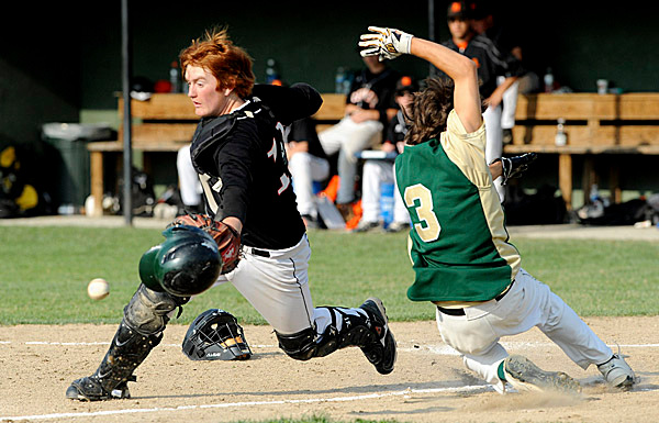 Brewer High School's #10 Tyler White (left) can't catch the wide throw as Oxford Hills High School's #3 Chris Priest slides to home plate to score his team's 8th run during the second inning of the Easter Maine Class A Baseball final game against  in Augusta Tuesday afternoon. BANGOR DAILY NEWS PHOTO BY GABOR DEGRE