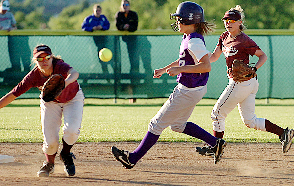 Woodland's Molly White (center) is chased to second base by George Stevens' Amber Gray (right) as short stop Richelle Kane (left) anticipates the throw in the first inning of Tuesday's Eastern Maine final, June 15, 2010 at Coffin Field in Brewer. BANGOR DAILY NEWS PHOTO BY BRIDGET BROWN