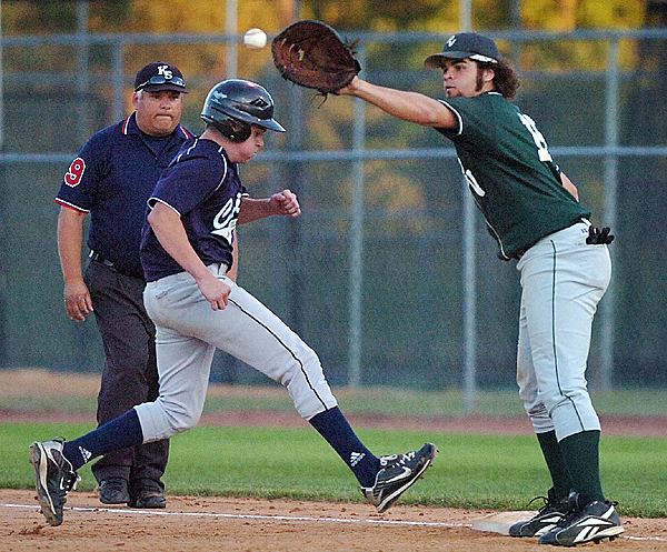 Calais' Dylan Carter (left) hustles back to first as Penobscot Valley's Adam Callender anticipates the ball in the fourth inning of Tuesday's Eastern Maine Class C final, June 15, 2010 at Mansfield Stadium in Bangor. (Bangor Daily News/Bridget Brown)