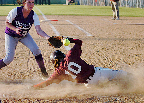 George Stevens senior Lydia Clapp (10) slides into home plate ahead of an attempted tag by Woodland pitcher Shelby Bassett in the second inning of Tuesday's Eastern Maine final, June 15, 2010 at Coffin Field in Brewer. BANGOR DAILY NEWS PHOTO BY BRIDGET BROWN