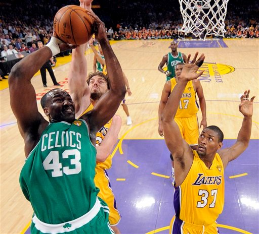 Boston Celtics center Kendrick Perkins shoots as Los Angeles Lakers forwards Ron Artest (37) and Pau Gasol of Spain, back left, defend during the first half of Game 6 of the NBA basketball finals Tuesday, June 15, 2010, in Los Angeles. Perkins left the game with a sprained knee in the first quarter. (AP Photo/Mark J. Terrill, Pool)
