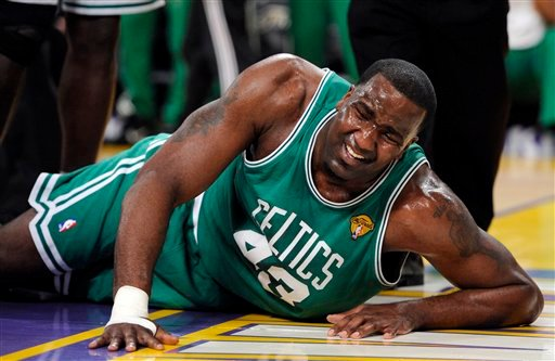Boston Celtics center Kendrick Perkins lies on the floor after apparently suffering an injury during the first half of Game 6 of the NBA basketball finals against the Los Angeles Lakers on Tuesday, June 15, 2010, in Los Angeles. (AP Photo/Mark J. Terrill)