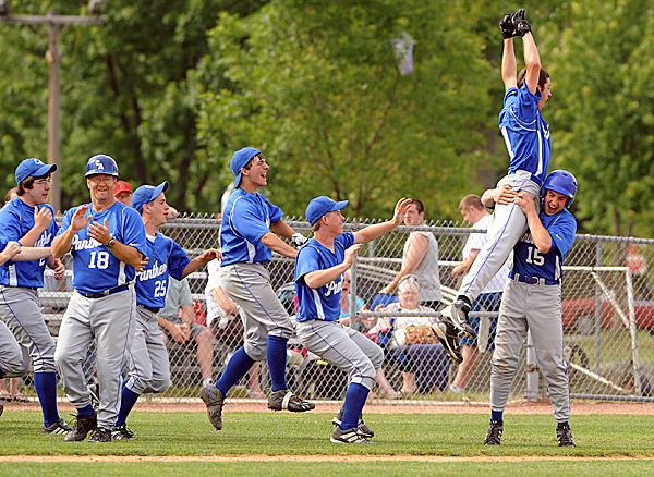 Central Aroostook High School's Logan McLaughlin leaps into the arms of Kasey Brewer after scoring his team's 10th run, ending the game at the bottom of the 6th inning.  Central Aroostook won the Eastern Maine Class D baseball championship game 10-0 against Deer Isle-Stonington High School at Mansfield Stadium in Bangor Wednesday afternoon.  BANGOR DAILY NEWS PHOTO BY GABOR DEGRE