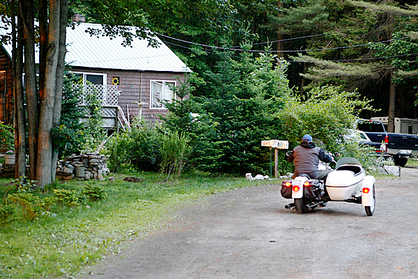 A motorcyclist arrives at an Old Orchard Beach, Maine house that was the location of a shootout between federal agents and people at the home is seen Tuesday, June 15, 2010. Agents were attempting to arrest two members of the Outlaws motorcycle gang as part of a seven-state sweep when they shot and killed one of them in an early morning gunfight Tuesday.  (AP Photo/Joel Page)