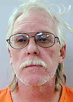 59 year old Kenneth Dulac of Windsor was arrested and charged with robbery .