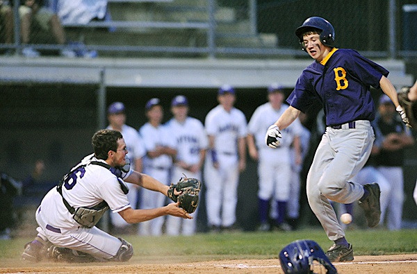 Bucksport High School's Cody Farrell (right) runs to the home plate beating the throw to Waterville high School's Brendan Scully during the sixth inning of the Eastern Maine Class B Baseball Championship game in Bangor Wednesday evening.   BANGOR DAILY NEWS PHOTO BY GABOR DEGRE