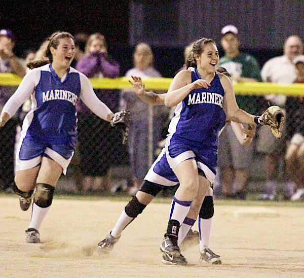 Mariners' pitcher Sydney Ouzts , right, and third baseman Erika Hutchins celebrate as centerfielder Hannah Siebert makes the catch for the final out in the seventh inning to give them the win over Southern Aroostook in Brewer, Wed., June 16, 2010. BANGOR DAILY NEWS PHOTO BY MICHAEL C. YORK