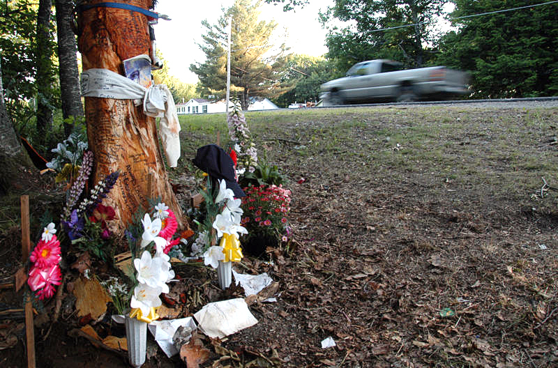 A memorial as seen Thursday at the tree where three Greenbush women were killed on Tuesday. BDN PHOTOS BY NICK SAMBIDES JR.