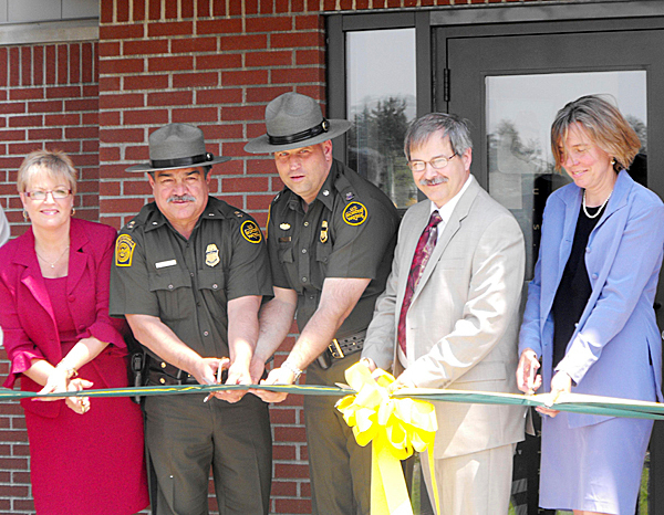 Approximately 70 people turned out on Friday afternoon for the official opening of the Fort Fairfield U.S. Border Patrol Station on the Limestone Road. The new $6.5 million, 26,000 square-foot-facility sits on 10 acres and is just across the road from the old station. Cutting the ribbon are, from left: Sharon Campbell, regional representative for U.S. Sen. Olympia Snowe; Alfredo Casillas, deputy chief patrol agent for the Border Patrol, Houlton sector; Dennis Harmon, agent in charge, Border Patrol; Phil Bosse, regional representative for U.S. Sen. Susan Collins, and Barbara Hayslett, district representative for U.S. Congressman Mike Michaud.  BANGOR DAILY NEWS PHOTO BY JEN LYNDS