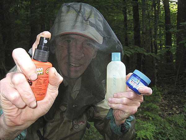 Brad Viles displays his favorite combination of weapons for fighting black flies, mosquitoes, deer and moose flies and ticks. Left to right, Ben's 100; a head net and no-see-um mesh shirt; Avon Skin So Soft bath oil, and Vicks Vapo Rub.