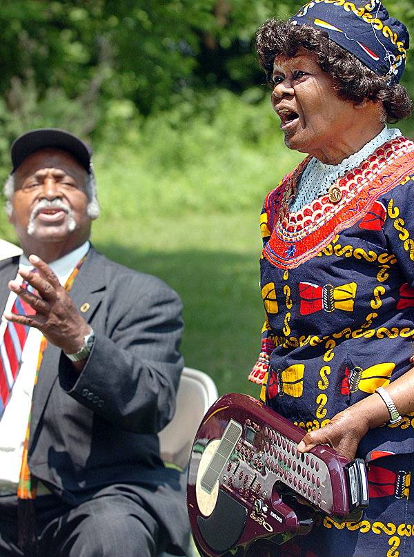 Mary Hunter of Bangor leads the singing of &quotGod Bless America&quot alongside James Varner (left) at the fifth annual Maine Human Rights Coalition Juneteenth Day celebration, which honors the freeing of slaves in the U.S., at Chamberlain Freedom Park in Brewer on Friday, June 18, 2010.    BANGOR DAILY NEWS PHOTO BY BRIDGET BROWN