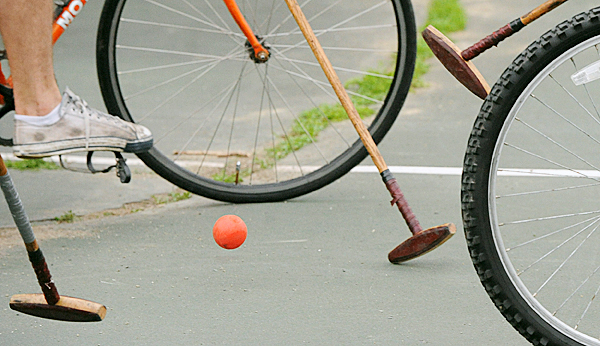 Participants battle for controll of the ball wile playing bike polo at the Newbury Street Park in Bangor.  BANGOR DAILY NEWS PHOTO BY GABOR DEGRE